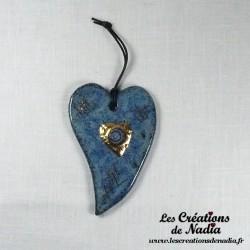 Coeur or allongé bleu