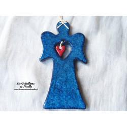 Grand ange bleu en poterie