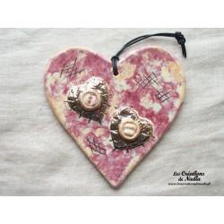 Coeur en céramique en or et parme
