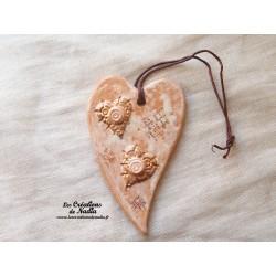 Coeur allongé en céramique en or et vanille