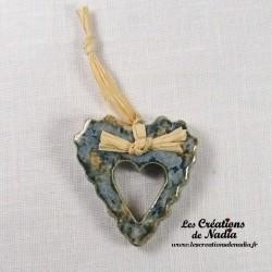 Moyen coeur dentelé bleu-gris marbré