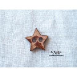 Bouton petite étoile doré