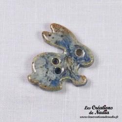 Bouton lapin bleu-gris marbré