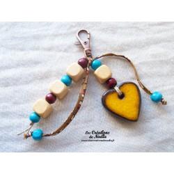 Grigri bijoux de sac jaune bouton d'or