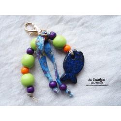 Grigri bijoux de sac porte clés bleu