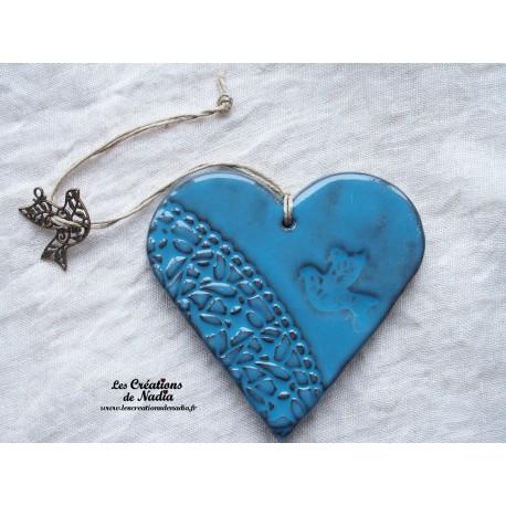 Coeur en céramique bleu breloque colombe