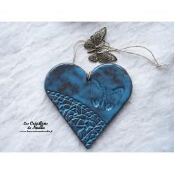 Coeur en céramique bleu canard breloque papillon