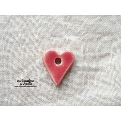 Bouton coeur rose bonbon un trou