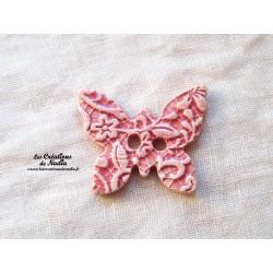 Bouton papillon couleur rose bonbon