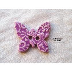 Bouton papillon couleur lilas