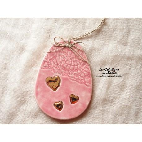 Oeuf en céramique couleur rose