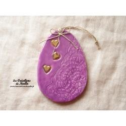 Oeuf en céramique couleur lilas