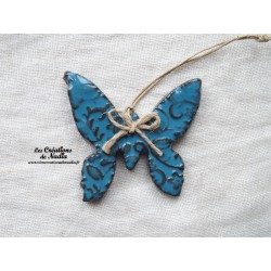 Papillon couleur bleu canard impressions fines dentelles
