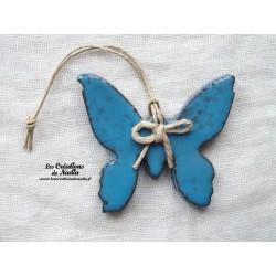 Papillon couleur bleu canard impressions florales