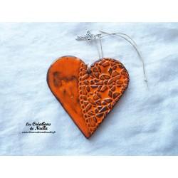 Coeur en céramique orange breloque crucifix