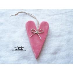 Coeur allongé rose bonbon