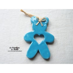 Ourson en céramique de couleur bleu lagon