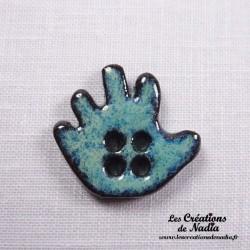 Bouton grande main gauche turquoise